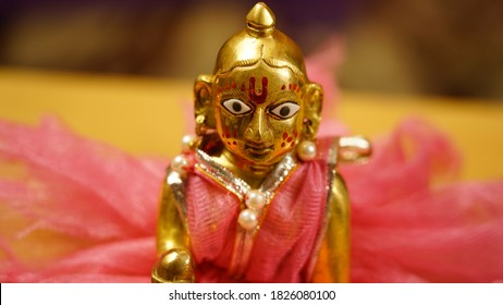 Lord Krishna also known as laddu gopal sculpture in beautiful clothes close up