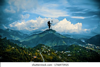 LORD SHIVA STANDING AT THE TOP OF THE MOUNTAIN