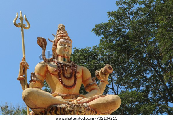 Lord Siva Trident Drum Against Sky Stock Photo (Edit Now