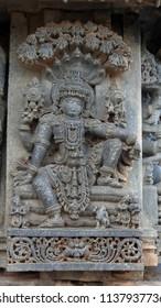 Lord Vishnu on Seshnag - Lakshmi Narasimha Temple, Nuggehalli, Hassan District of Karnataka state, India. The temple was built in 1246 CE rule of Hoysala Empire.
