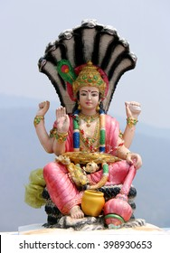 Lord Vishnu statue in a sitting position.
