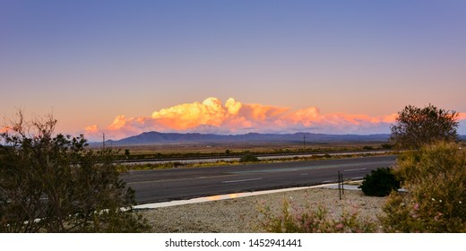 Lordsburg, New Mexico - Looking east across Hwy 10, with sun setting behind camera.