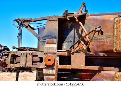Lordsburg, New Mexico , USA: Circa September 2019 Wrecked and rusting old railroad freight cars from a derailment near Lordsburg, New Mexico.