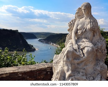 Loreley (heine) by Rhine in Germany. Beautiful view from the high cliff and the famous statue on top of it who is telling.