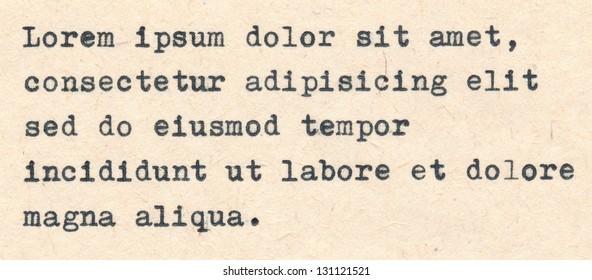 Lorem ipsum written with a typewriter on an aged paper.