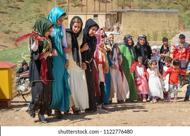 Lorestan Province, Iran - April 1, 2018: Iranian women dansing Lurish Cupi dances on wedding ceremony in the village.