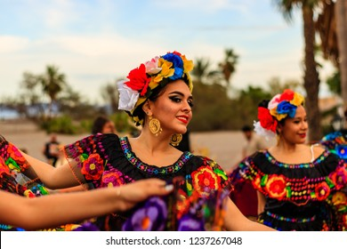 Loreto, Mexico - 2018 Folkloric dance on a beach in Loreto, Mexico. Young girl dancing,