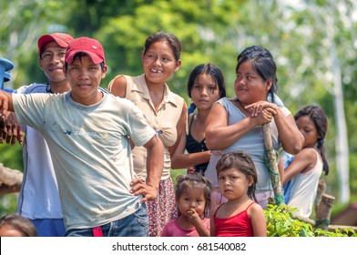 LORETO, PERU - JANUARY 02: Unidentified locals posing for camera in a small village in the middle of the Amazon Rain Forest, on January 02, 2010 in Loreto, Peru.