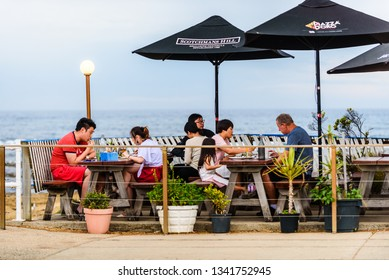 Lorne, Victoria, Australia, January 17th 2019: People are eating at an seaside outdoor restaurant near the Lorne Pier