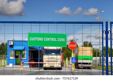 Lorries pass through the security checkpoint of the logistics complex with customs services.