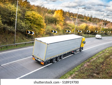 Lorry on the road in autumn scenery