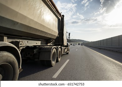 A lorry with tipping trailer in motion on the motorway.