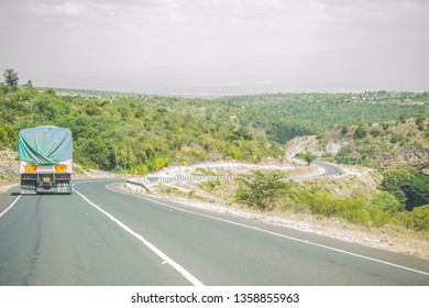 Lorry transporting goods on a tarmac road