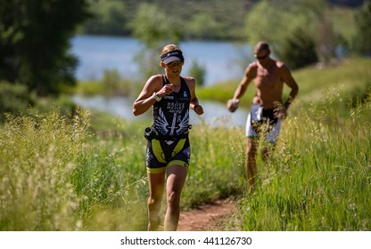 Lory State Park, CO, USA - June 18, 2016: Jordan Cooper of Gunnison runs the trails at XTERRA Lory en route to winning the female 25-29 age group.
