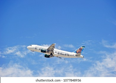 LOS ANGELE/CALIFORNIA - APRIL 21, 2018: Frontier Airlines Airbus A320 aircraft is airborne as it departs Los Angeles International Airport. Los Angeles, California USA