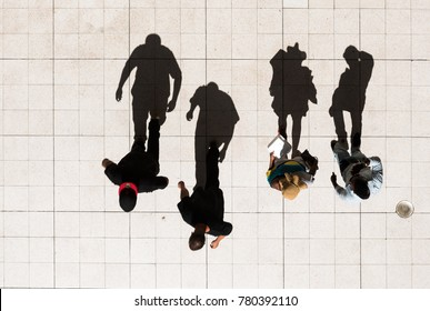 Los Angeles - 21 December, 2017: People walking on the street. Shot from above with long shadows in Los Angeles, CA