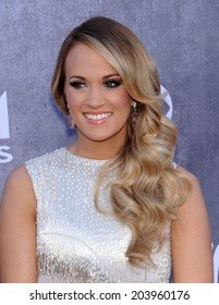 LOS ANGELES - APR 06:  Carrie Underwood arrives to the 49th Annual Academy of Country Music Awards   on April 06, 2014 in Las Vegas, NV.