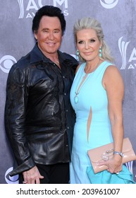 LOS ANGELES - APR 06:  Wayne Newton & Kathleen McCrone arrives to the 49th Annual Academy of Country Music Awards   on April 06, 2014 in Las Vegas, NV.