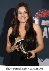 LOS ANGELES - APR 13:  Mila Kunis in the 2014 MTV Movie Awards - Press Room  on April 13, 2014 in Los Angeles, CA.
