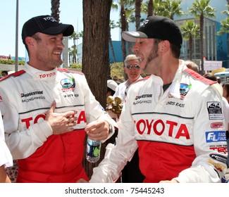 LOS ANGELES - APR 16:  Brian Austin Green, Chris Rado attends the Toyota Grand Prix Pro Celeb Race at the Toyota Grand Prix Track on April 16, 2011 in Long Beach, CA.