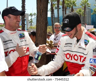 LOS ANGELES - APR 16:  Brian Austin Green, Chris Rado attend the Toyota Grand Prix Pro Celeb Race at the Toyota Grand Prix Track on April 16, 2011 in Long Beach, CA.