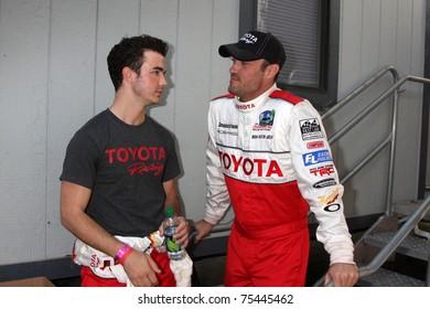 LOS ANGELES - APR 16:  Kevin Jonas, Brian Austin Green attend the Toyota Grand Prix Pro Celeb Race at the Toyota Grand Prix Track on April 16, 2011 in Long Beach, CA.