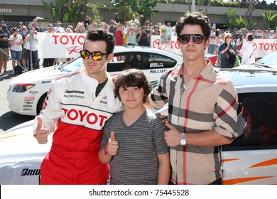 LOS ANGELES - APR 16:  Kevin Jonas, Frankie Jonas, Nick Jonas  attend the Toyota Grand Prix Pro Celeb Race at the Toyota Grand Prix Track on April 16, 2011 in Long Beach, CA.