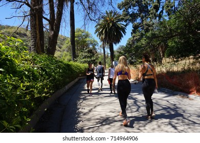 LOS ANGELES, APR 30TH, 2017: Hikers walk on a trail near the entrance to Runyon Canyon Park in the Hollywood Hills, Santa Monica Mountains, California.
