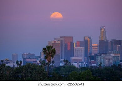 LOS ANGELES - April 21, 2016: Full moon rising over downtown Los Angeles skyline.