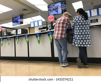 LOS ANGELES, April 25, 2019: DMV Department of Motor Vehicles Culver City interior. Close up of a couple standing at the counter at the DMV field office.