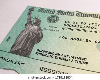LOS ANGELES, April 28th, 2020: United States Treasury Economic Impact Payment stimulus check for Coronavirus COVID-19 relief. Close up with focus on controversial President Donald J. Trump imprint.