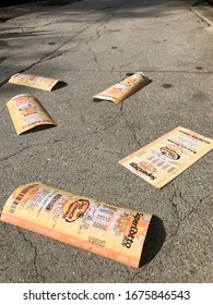 LOS ANGELES, April 7th, 2019: Discarded Lotto tickets lying abandoned on the sidewalk of a Hollywood street close up.