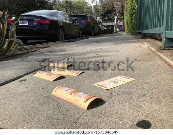 LOS ANGELES, April 7th, 2019: Discarded Lotto tickets lying abandoned on the sidewalk of a Hollywood street.