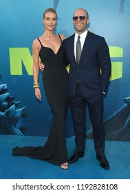"""LOS ANGELES - AUG 06:  Rosie Huntington-Whiteley and Jason Statham arrives to the """"The Meg"""" US Premiere  on August 6, 2018 in Hollywood, CA"""