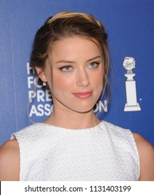 LOS ANGELES - AUG 13:  Amber Heard arrives to the Hollywood Foreign Press Association Installation Luncheon  on August 13, 2013 in Hollywood, CA