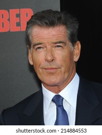 """LOS ANGELES - AUG 13:  Pierce Brosnan arrives to the """"The November Man"""" World Premiere  on August 13, 2014 in Hollywood, CA."""