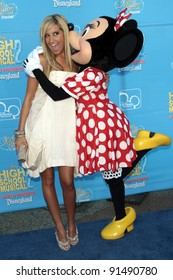 LOS ANGELES - AUG 14: Actress Ashley Tisdale gets a kiss from Minnie Mouse 14 August 2007 in Los Angeles, California