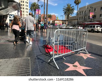 LOS ANGELES, AUG 30, 2018: Barricades surround President Donald Trump's star on the Hollywood Walk of Fame, near Hollywood Boulevard and Highland. It was vandalized on July 25.
