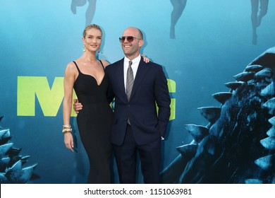"LOS ANGELES - AUG 6:  Rosie Huntington-Whiteley, Jason Statham at the ""The Meg"" Premiere on the TCL Chinese Theater IMAX on August 6, 2018 in Los Angeles, CA"