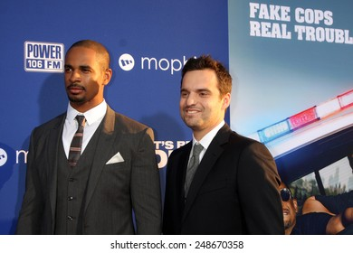 """LOS ANGELES - AUG 7:  Damon Wayans Jr, Jake Johnson at the """"Let's Be Cops"""" Premiere at the ArcLight Hollywood Theaters on August 7, 2014 in Los Angeles, CA"""
