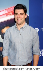 """LOS ANGELES - AUG 7:  Max Greenfield at the """"Let's Be Cops"""" Premiere at the ArcLight Hollywood Theaters on August 7, 2014 in Los Angeles, CA"""