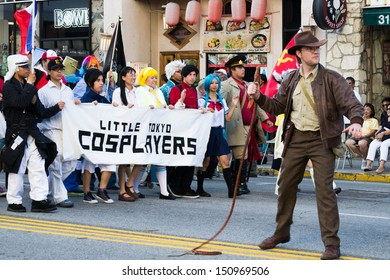 LOS ANGELES - AUGUST 11: Comic Fans in the 73th Annual Nisei Week Grand Parade - August 11, 2013 in downtown Los Angeles, CA.
