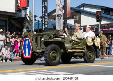 LOS ANGELES - AUGUST 11:  Jeep with World War II Veterans in the 73th Annual Nisei Week Grand Parade - August 11, 2013 in downtown Los Angeles, CA.