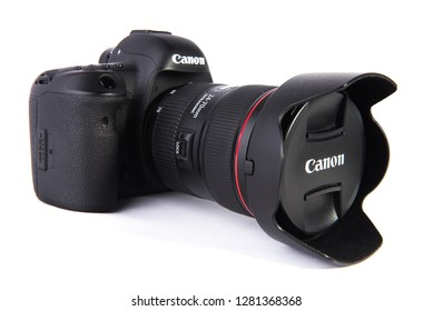 Los Angeles, CA: 1/11/2018 - Canon 5D MARK IV DSLR camera with 24-70mm lens attached isolated on white background.