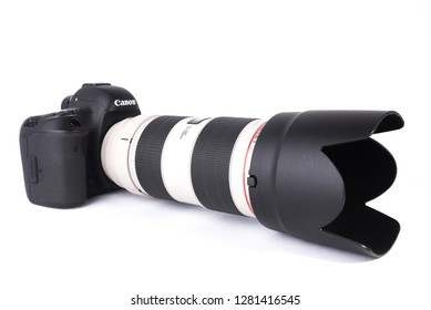 Los Angeles, CA: 1/11/2018 - Canon 5D MARK IV DSLR camera with 70-200mm F2.8L IS II lens isolated on white background.