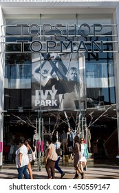 Los Angeles, CA: 7/10/2016:  Shoppers walking past a Topshop store in the Los Angeles area.  Topshop was founded in 1964.