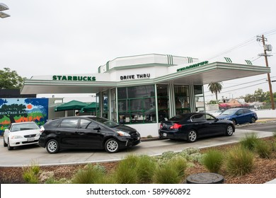 Los Angeles, CA: 7/16/2016: Starbucks Drive-Thru location in Los Angeles, California. Starbucks is a global coffee chain with 23,768 stores worldwide.