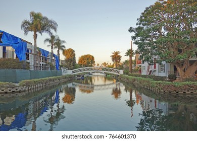 LOS ANGELES, CA -8 OCT 2017- Sunset over the Venice Canal Historic District, a landmark historical neighborhood of Los Angeles, California, with man-made water canals.