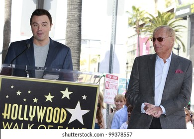 LOS ANGELES, CA - APR 5: Seth MacFarlane, Adam West at a ceremony where Adam West is honored with a star on the Hollywood Walk of Fame on April 5, 2012 in Los Angeles, California