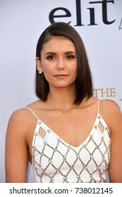 """LOS ANGELES, CA. April 12, 2017: Actress Nina Dobrev at the premiere for """"The Promise"""" at the TCL Chinese Theatre, Hollywood."""